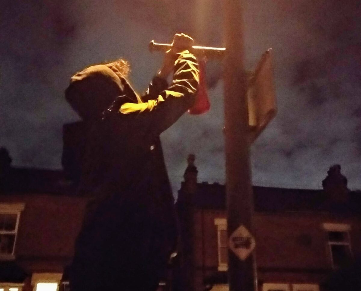 putting a flag on a lampost